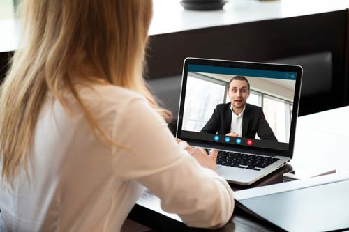 Virtual CFO Working With Client On Laptop Over Video Meeting