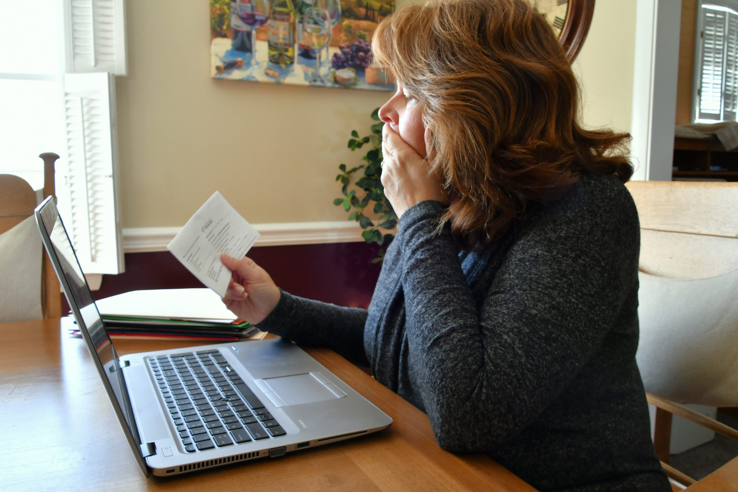 Smiling Female Tax Professional In Dark Grey Blazer